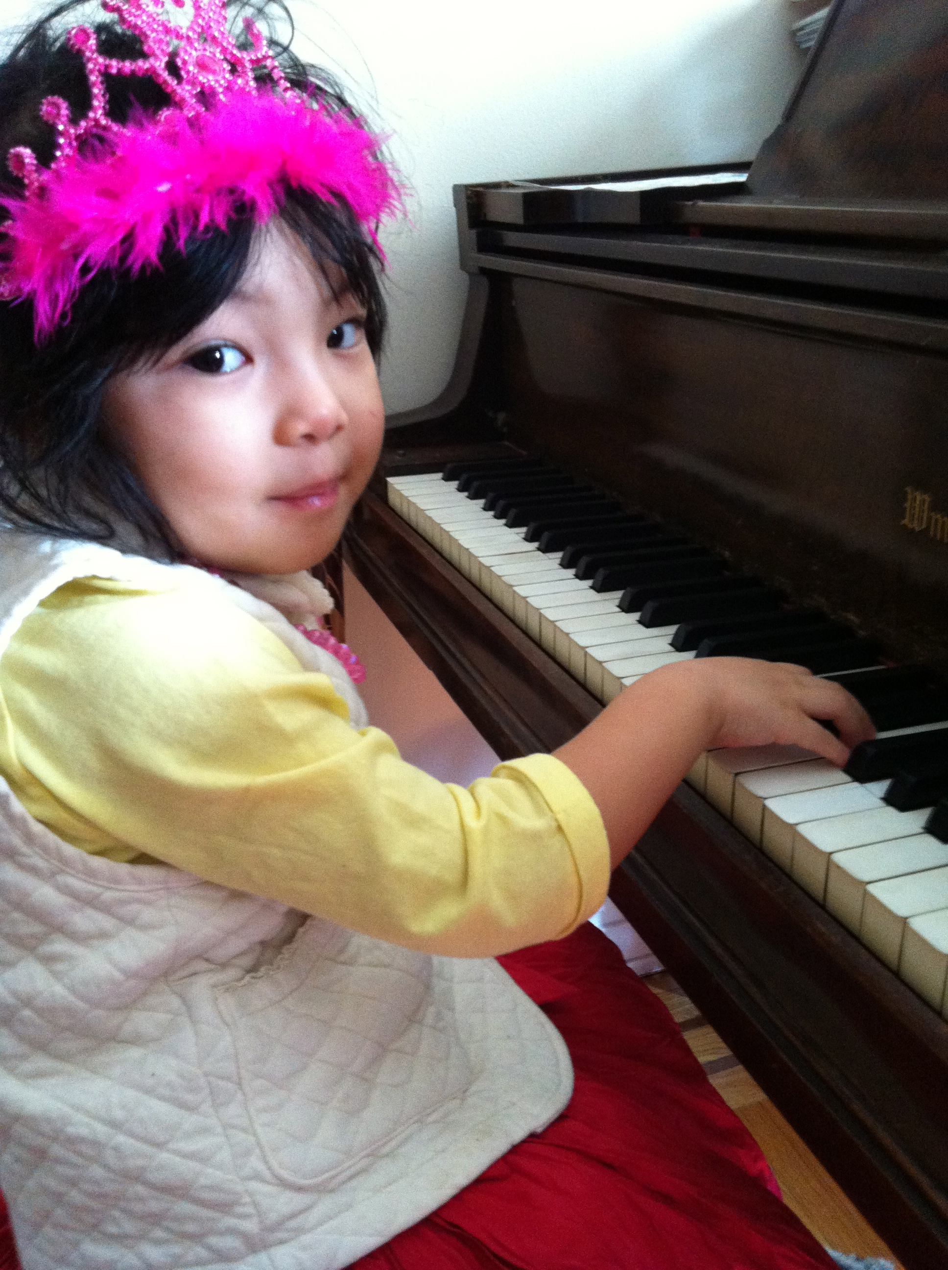 Our youngest student, 3year old and having fun playing piano!